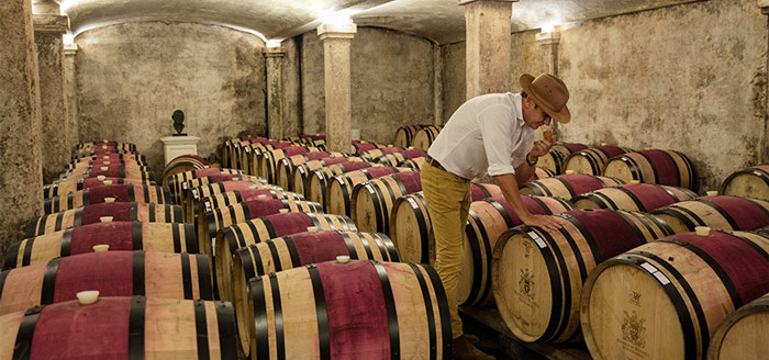 42-Proprietor-Anthony-Hamilton-Russell-in-the-Pinot-noir-barrel-cellar-checking-new-and-older-wood-prior-to-stacking_ny